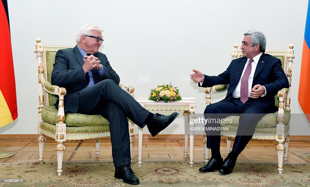 Armenia's President Serzh Sarkisian (R) speaks with German Foreign Minister Frank-Walter Steinmeier, who currently chairs the Organisation for Security and Cooperation in Europe (OSCE) monitoring body, during their meeting in Yerevan on June 29, 2016. / AFP / KAREN