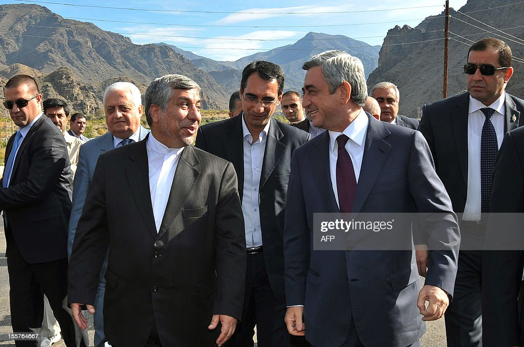 Armenia's President Serzh Sarkisian (front R) speaks with Iran's Energy Minister Majid Namjoo (front L) as they meet at the construction site of a joint hydro-electric power plant on the Arax River near the southern Armenian town of Meghri on the Armenian-Iranian border, on November 8, 2012. Armenia and Iran started today to construct a joint hydro-electric power plant on their shared border as the Christian and Muslim neighbours sought to boost economic ties.The $323-million (253-million-euro), 130-megawatt plant is due to be completed in five years, and will supply energy to Iran for the first 15 years before being handed over to Armenia.