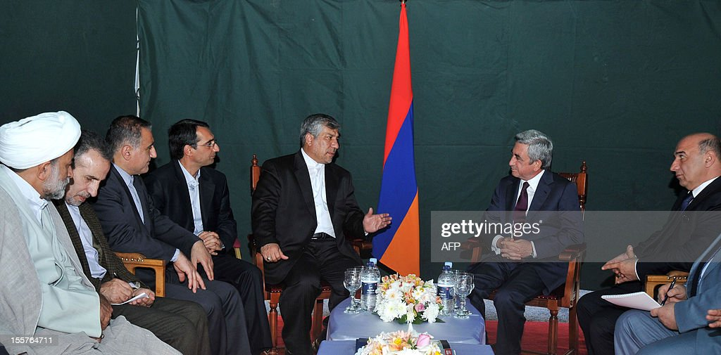 Armenia's President Serzh Sarkisian (back R) speaks with Iran's Energy Minister Majid Namjoo (back L) as they meet at the construction site of a joint hydro-electric power plant on the Arax River near the southern Armenian town of Meghri on the Armenian-Iranian border, on November 8, 2012. Armenia and Iran started today to construct a joint hydro-electric power plant on their shared border as the Christian and Muslim neighbours sought to boost economic ties.The $323-million (253-million-euro), 130-megawatt plant is due to be completed in five years, and will supply energy to Iran for the first 15 years before being handed over to Armenia.