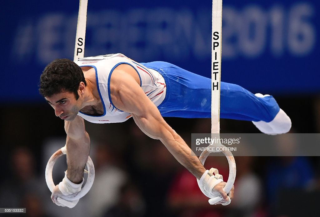 Armenias Vahagn Davtyan performs during the Mens Rings competition of the European Artistic Gymnastics Championships 2016 in Bern, Switzerland on May 29, 2016. / AFP / FABRICE
