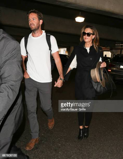 Armie Hammer and Elizabeth Chambers are seen at LAX on April 11 2017 in Los Angeles California