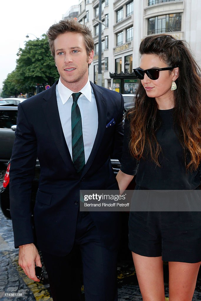 <a gi-track='captionPersonalityLinkClicked' href=/galleries/search?phrase=Armie+Hammer&family=editorial&specificpeople=5313113 ng-click='$event.stopPropagation()'>Armie Hammer</a> and <a gi-track='captionPersonalityLinkClicked' href=/galleries/search?phrase=Elizabeth+Chambers&family=editorial&specificpeople=5295153 ng-click='$event.stopPropagation()'>Elizabeth Chambers</a> arrive at the Paris Premiere of 'Lone Ranger' at UGC Normandy on July 24, 2013 in Paris, France.