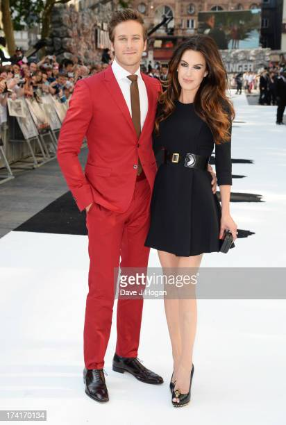 Armie Hammer and Elizabeth Chambers attend the UK premiere of 'The Lone Ranger' at The Odeon Leicester Square on July 21 2013 in London England