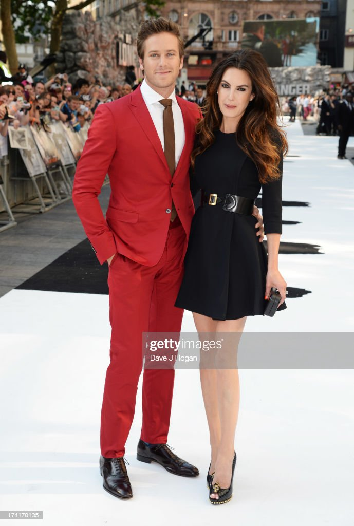 Armie Hammer and Elizabeth Chambers attend the UK premiere of 'The Lone Ranger' at The Odeon Leicester Square on July 21, 2013 in London, England.