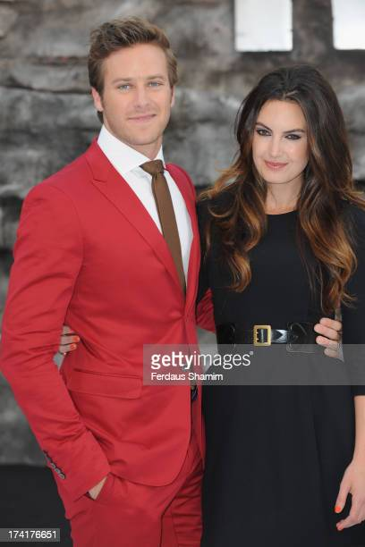 Armie Hammer and Elizabeth Chambers attend the UK Premiere of 'The Lone Ranger' at Odeon Leicester Square on July 21 2013 in London England