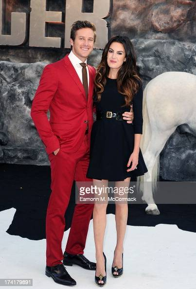 Armie Hammer and Elizabeth Chambers attends the UK Premiere of 'The Lone Ranger' at Odeon Leicester Square on July 21 2013 in London England