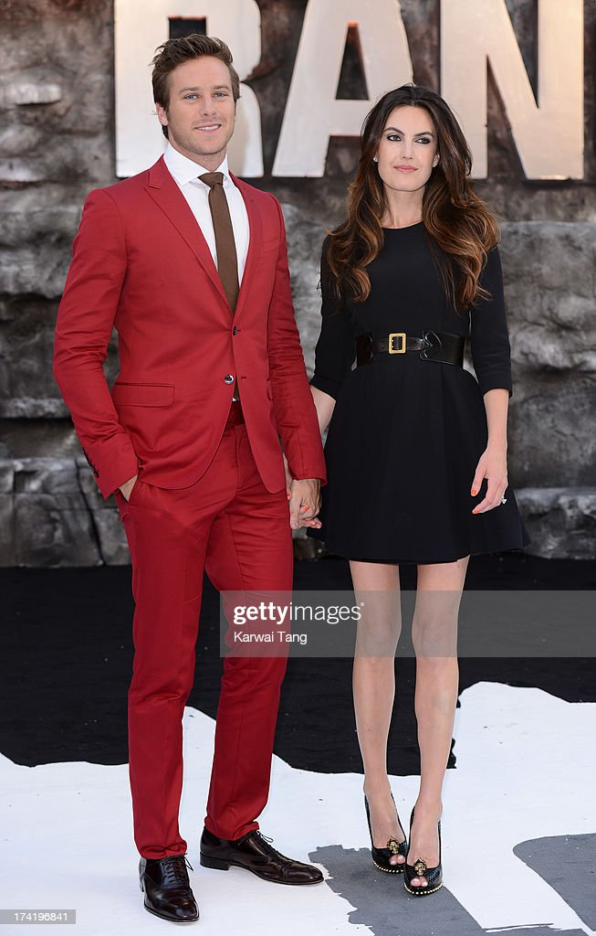 Armie Hammer and Elizabeth Chambers attends the UK Premiere of 'The Lone Ranger' at Odeon Leicester Square on July 21, 2013 in London, England.