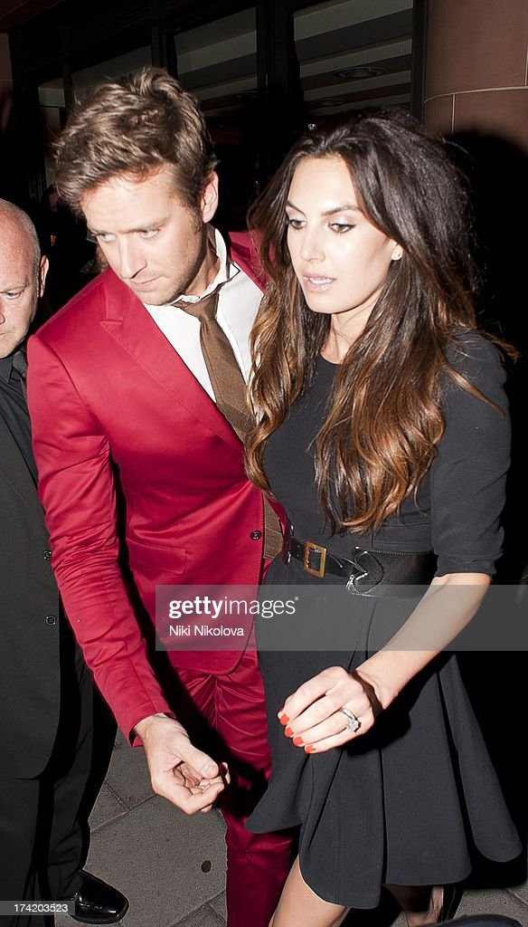 <a gi-track='captionPersonalityLinkClicked' href=/galleries/search?phrase=Armie+Hammer&family=editorial&specificpeople=5313113 ng-click='$event.stopPropagation()'>Armie Hammer</a> and <a gi-track='captionPersonalityLinkClicked' href=/galleries/search?phrase=Elizabeth+Chambers&family=editorial&specificpeople=5295153 ng-click='$event.stopPropagation()'>Elizabeth Chambers</a> leaving the C Restaurant, Mayfair on July 21, 2013 in London, England.