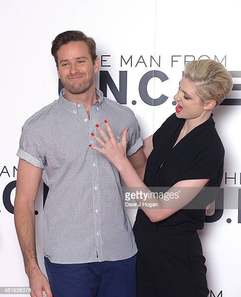REQUIRED Armie Hammer and Elizabeth Debicki attend 'The Man from UNCLE' photocall at Claridge's Hotel on July 23 2015 in London England