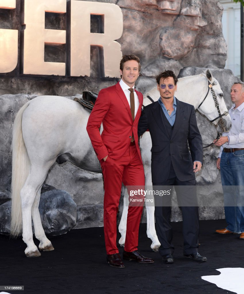 Armie Hammer and Johnny Depp attend the UK Premiere of 'The Lone Ranger' at Odeon Leicester Square on July 21, 2013 in London, England.