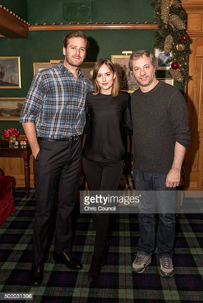 Armie Hammer Dakota Johnson and Judd Apatow attend the Audi Q7 Holiday and Snow Polo Celebration on December 19 2015 in Aspen Colorado