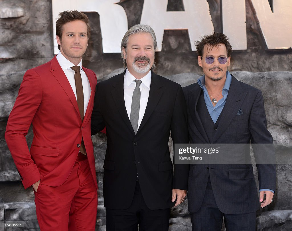 Armie Hammer Gore Verbinski and Johnny Depp attend the UK Premiere of 'The Lone Ranger' at Odeon Leicester Square on July 21 2013 in London England