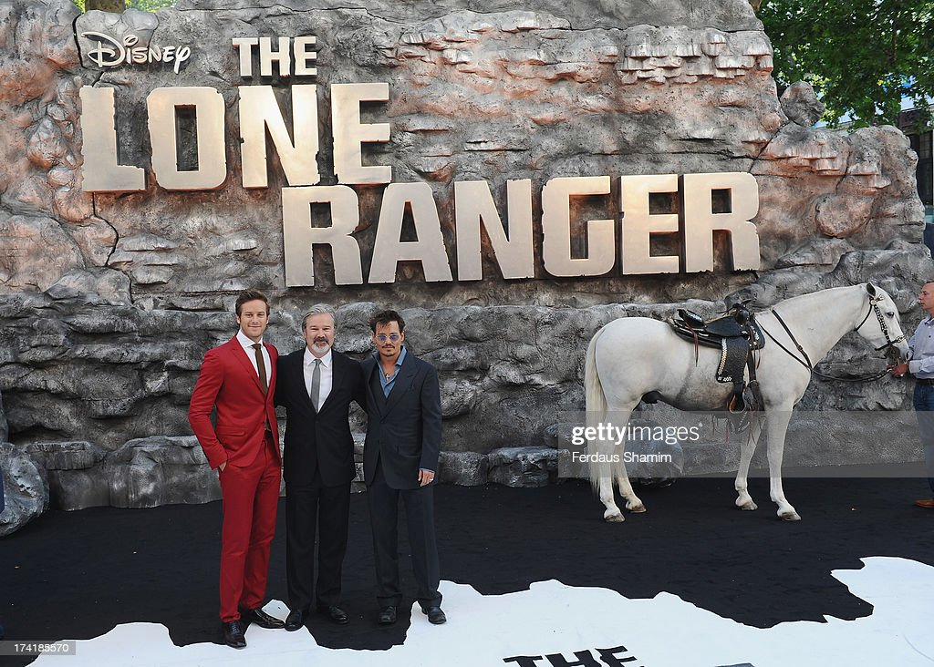 Armie Hammer Gore Verbinski and Jonny Depp attend the UK Premiere of 'The Lone Ranger' at Odeon Leicester Square on July 21 2013 in London England