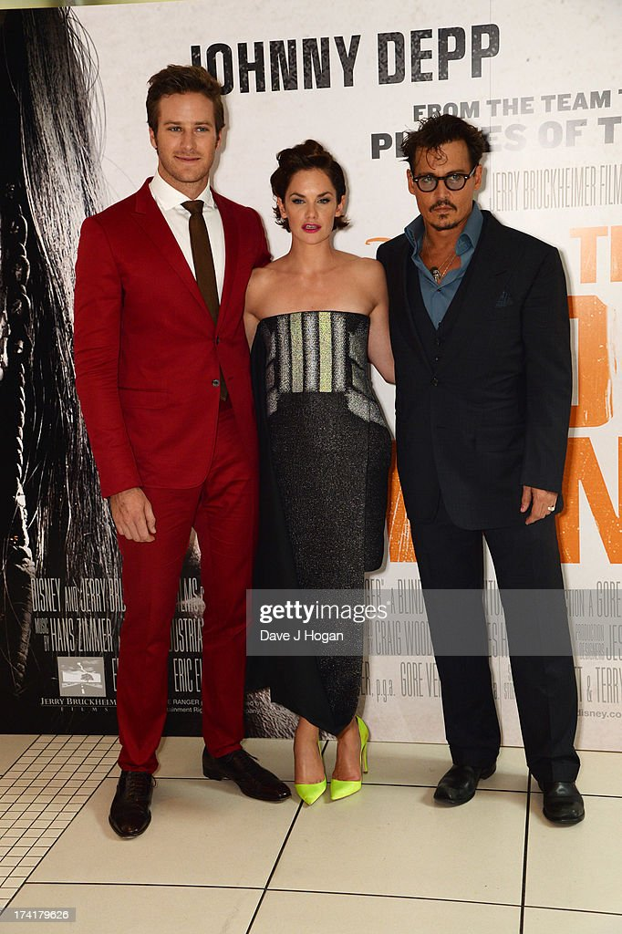 Armie Hammer, Ruth Wilson and Johnny Depp attend the UK premiere of 'The Lone Ranger' at The Odeon Leicester Square on July 21, 2013 in London, England.