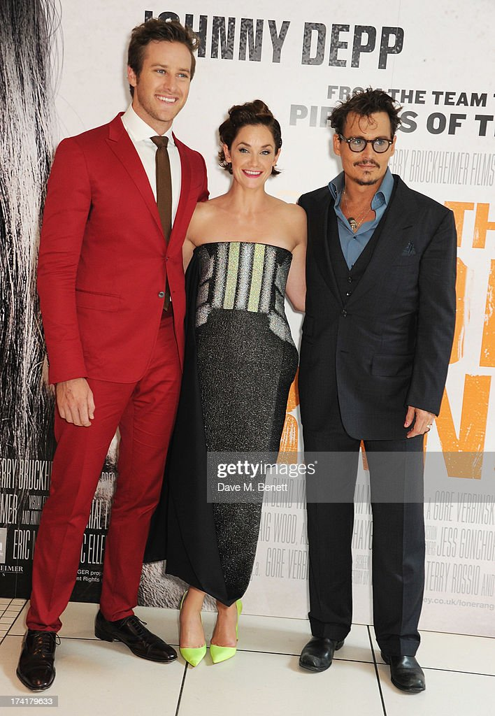 Armie Hammer, Ruth Wilson and Johnny Depp attend the UK Premiere of 'The Lone Ranger' at Odeon Leicester Square on July 21, 2013 in London, England.