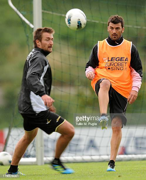 Armin Bacinovic and Cesare Bovo of Palermo in action during a Palermo training session at Sport Well Center on July 18 2011 in Malles Venosta near...