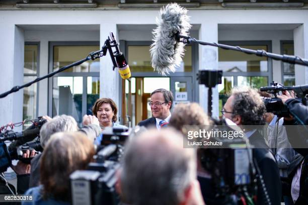 Armin Laschet lead candidate of the German Christian Democrats gives an interview next to his wife Susanne Laschet after casting his ballot in state...
