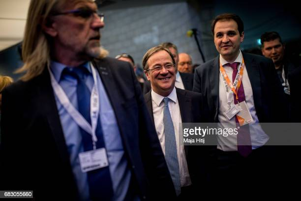 Armin Laschet lead candidate of the German Christian Democrats smiles while surrounded by security after CDU won the state elections in North...