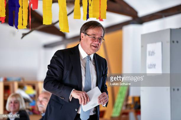 Armin Laschet lead candidate of the German Christian Democrats arrives to vote in state elections in North RhineWestphalia on May 14 2017 in Aachen...