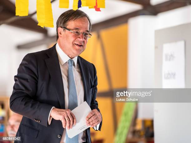 Armin Laschet lead candidate of the German Christian Democrats arrives to casts his ballot in state elections in North RhineWestphalia on May 14 2017...