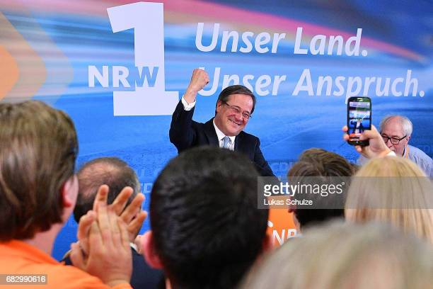Armin Laschet the lead candidate of the German Christian Democrats celebrates with supporters after the CDU win the North RhineWestphalia state...