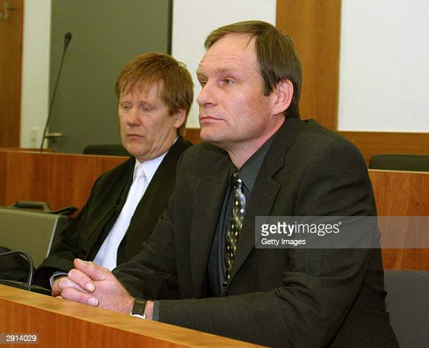 Armin Meiwes a 42yearold computer technician and selfconfessed cannibal and his lawyer Harald Ermel are seen in court on the last day of his trial...