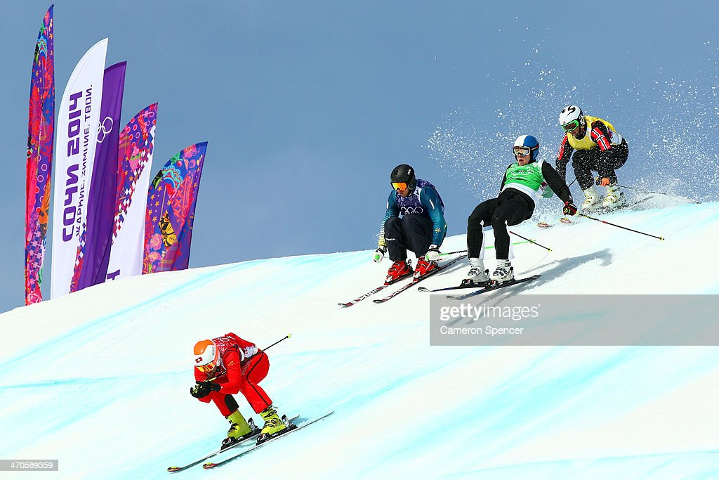 Armin Niederer of Switzerland leads from Scott Kneller (2ndL) of Australia during the Freestyle Skiing Men's Ski Cross 1/8 Finals on day 13 of the 2014 Sochi Winter Olympic at Rosa Khutor Extreme Park on February 20, 2014 in Sochi, Russia.