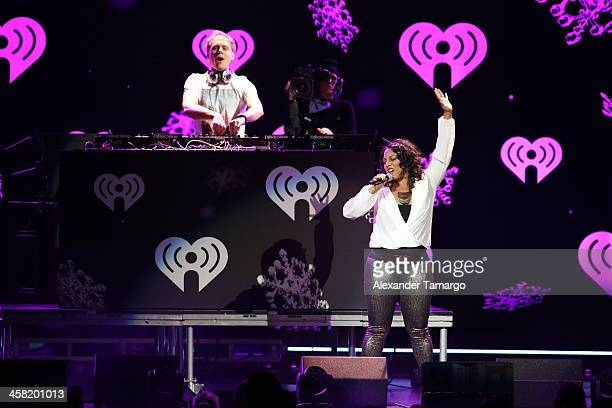 Armin van Buuren and Lauren Evans perform onstage during Y100's Jingle Ball 2013 Presented by Jam Audio Collection at BBT Center on December 20 2013...