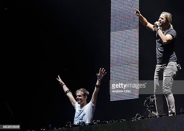 Armin Van Buuren and Trevor Guthrie perform on stage at Contact Winter Music Festival at BC Place on December 26 2014 in Vancouver Canada