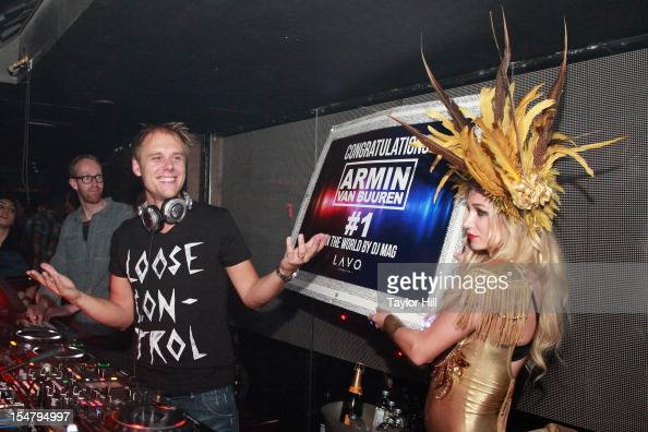 Armin van Buuren is presented with a sign celebrating his placement as DJ in the world by DJ Magazine at Lavo NY on October 26 2012 in New York City
