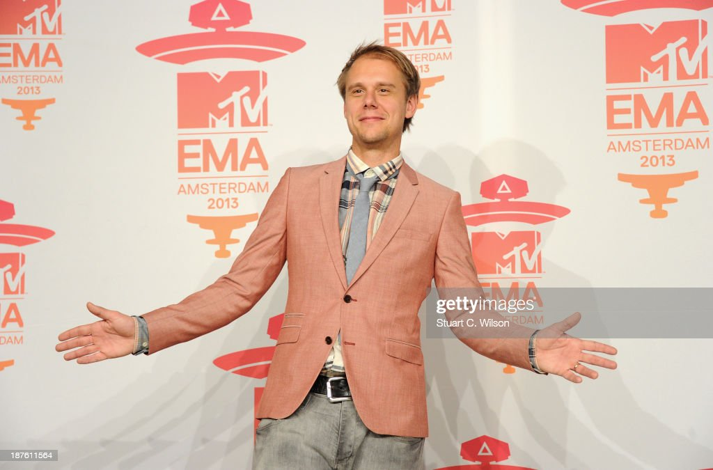 DJ <a gi-track='captionPersonalityLinkClicked' href=/galleries/search?phrase=Armin+van+Buuren&family=editorial&specificpeople=801189 ng-click='$event.stopPropagation()'>Armin van Buuren</a> poses in the photo room during the MTV EMA's 2013 at the Ziggo Dome on November 10, 2013 in Amsterdam, Netherlands.