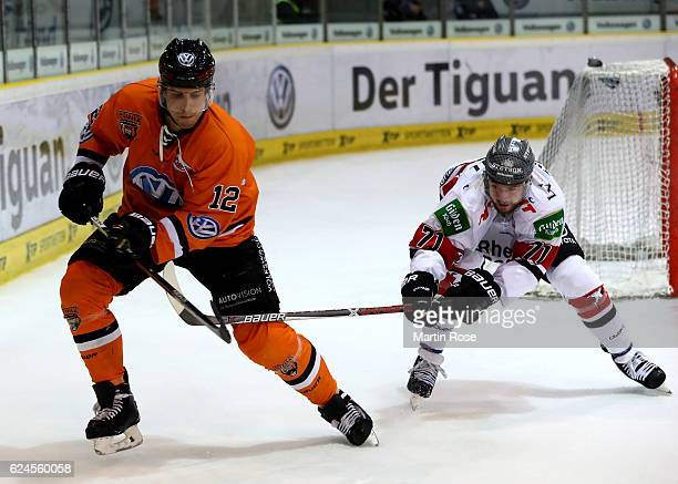 Armin Wurm of Wolfsburg and Travis Turnbull of Koeln battle for the puck during the DEL match between Grizzly Wolfsburg and Koelner Haie at BraWo Ice...