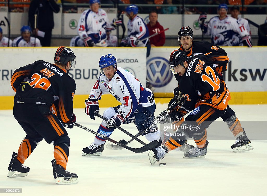 Armin Wurm (R) of Wolfsburg battles for the puck with Marcus Kink (L) of Mannheim during the DEL match between Wolfsburg Grizzly Adams and Adler Mannheim at Volksbank BraWo EisArena on November 25, 2012 in Wolfsburg, Germany.