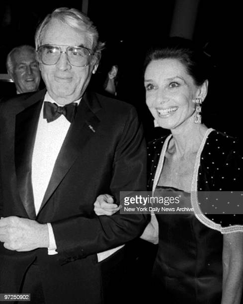ArmInArm to the fall dinner dance at the Museum of Modern Art go Gregory Peck and Audrey Hepburn