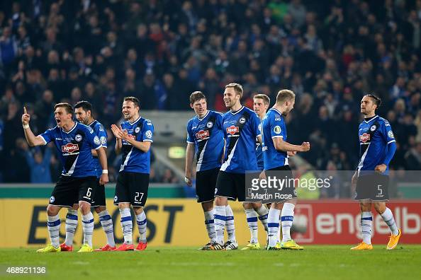 Arminia Bielefeld players celebrate during the penalty shootout during the DFB Cup Quarter Final match between Arminia Bielefeld and Borussia...