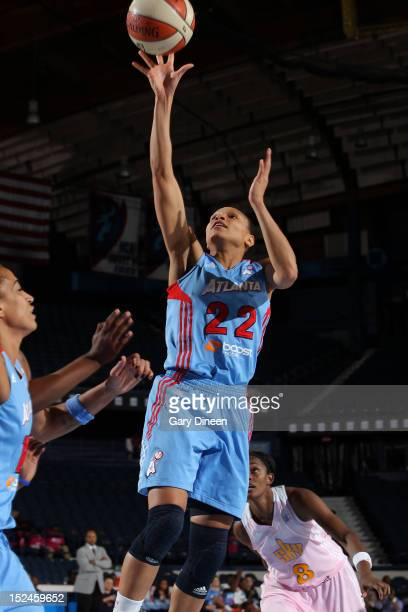 Arminte Price of the Atlanta Dream puts up a shot over Swin Cash of the Chicago Sky on September 20 2012 at the Allstate Arena in Rosemont Illinois...