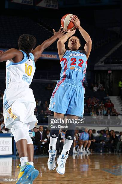Arminte Price of the Atlanta Dream shoots past Epiphanny Prince of the Chicago Sky on August 17 2012 at the Allstate Arena in Rosemont Illinois NOTE...