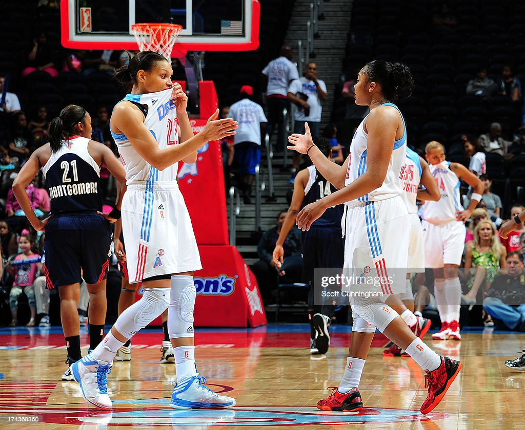 Armintie Herrington #22 and Alex Bentley #2 of the Atlanta Dream celebrate during the game against the Connecticut Sun at Philips Arena on July 24, 2013 in Atlanta, Georgia.