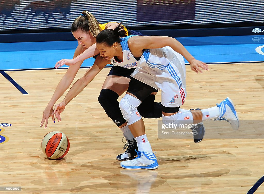 Armintie Herrington #22 of the Atlanta Dream battles for a loose ball against <a gi-track='captionPersonalityLinkClicked' href=/galleries/search?phrase=Jeanette+Pohlen&family=editorial&specificpeople=4225971 ng-click='$event.stopPropagation()'>Jeanette Pohlen</a> #32 of the Indiana Fever at Philips Arena on September 4 2013 in Atlanta, Georgia.