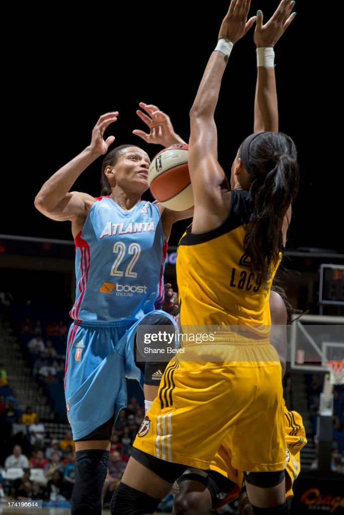 Armintie Herrington #22 of the Atlanta Dream is blocked by Jennifer Lacy #21 of the Tulsa Shock during the WNBA game on July 21, 2013 at the BOK Center in Tulsa, Oklahoma.