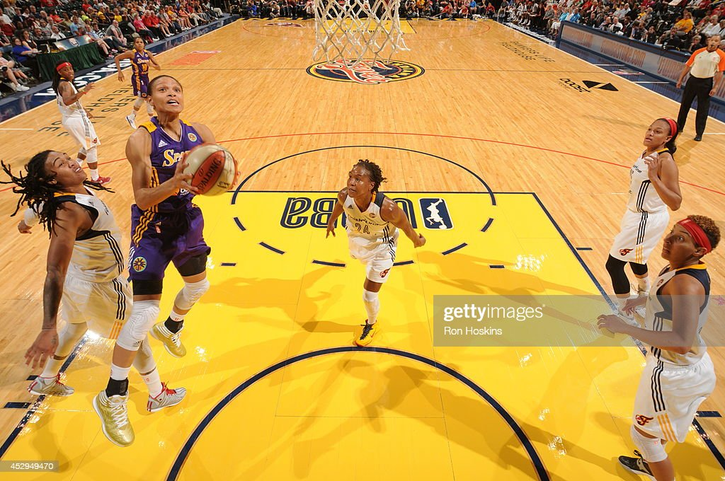 Armintie Herrington #22 of the Los Angeles Sparks goes to the basket against the Indiana Fever on July 15, 2014 at Bankers Life Fieldhouse in Indianapolis, Indiana.