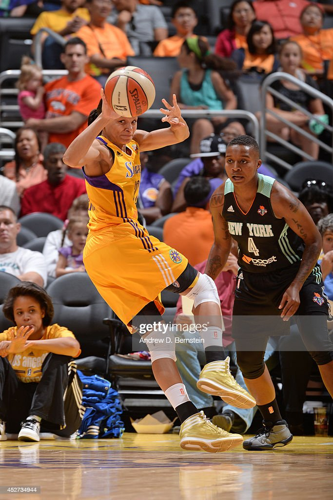 Armintie Herrington #22 of the Los Angeles Sparks passes the ball against the New York Liberty at STAPLES Center on July 23, 2014 in Los Angeles, California.