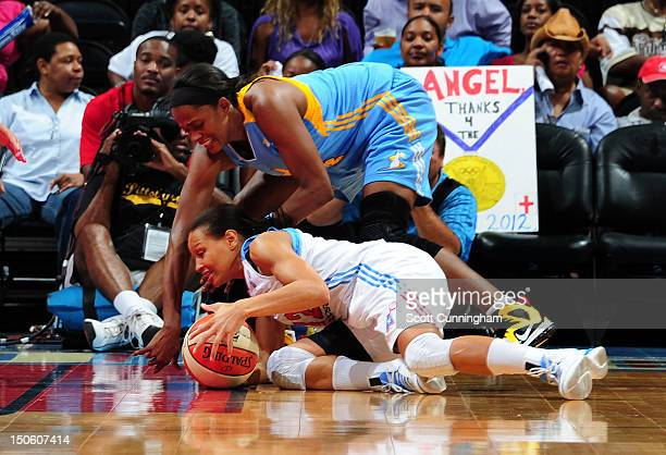 Armintie Price of the Atlanta Dream battles for a loose ball against Swin Cash of the Chicago Sky at Philips Arena on August 22 2012 in Atlanta...