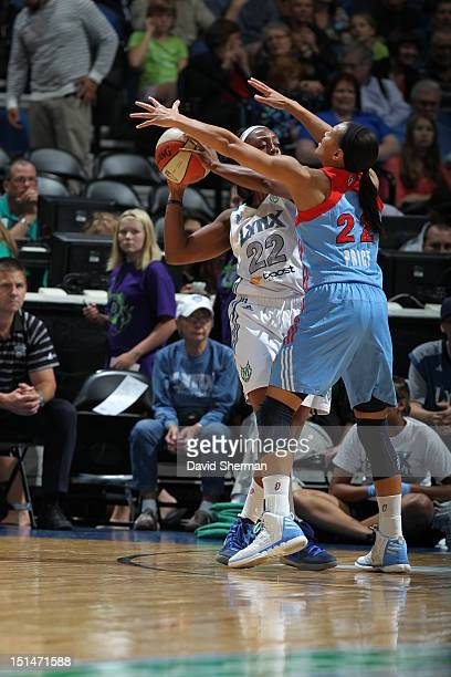 Armintie Price of the Atlanta Dream blocks Monica Wright of the Minnesota Lynx during the WNBA game on September 7 2012 at Target Center in...
