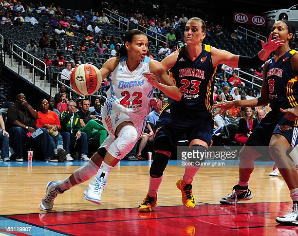 Armintie Price of the Atlanta Dream drives against Katie Douglas of the Indiana Fever during Game 2 of the Eastern Conference SemiFinals at Philips...