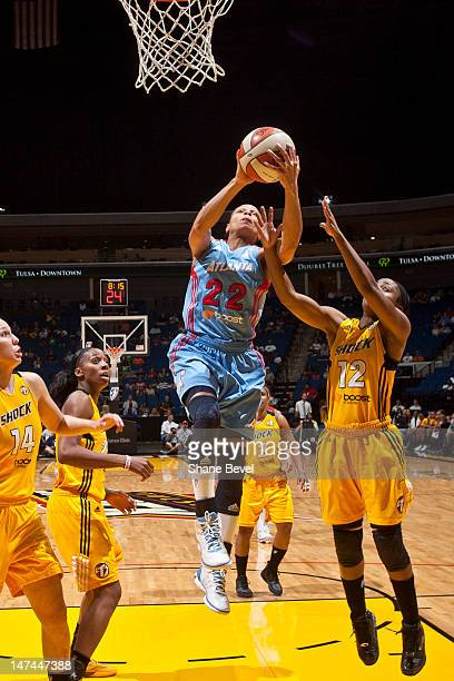 Armintie Price of the Atlanta Dream goes to the basket against Ivory Latta of the Tulsa Shock during the WNBA game on June 29 2012 at the BOK Center...