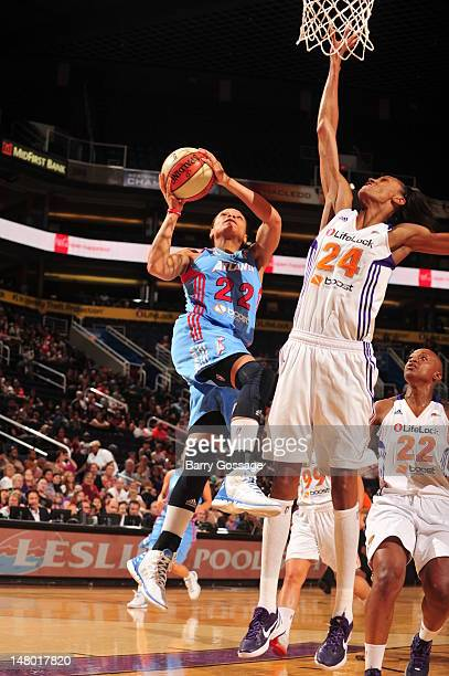 Armintie Price of the Atlanta Dream shoots against DeWanna Bonner of the Phoenix Mercury on July 07 2012 at US Airways Center in Phoenix Arizona NOTE...