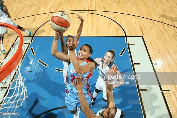 Armintie Price of the Atlanta Dream shoots the ball against Maya Moore of the Minnesota Lynx during the WNBA game on September 7 2012 at Target...
