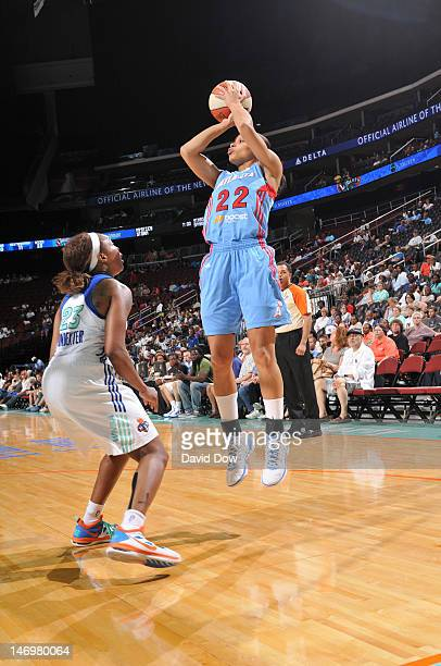 Armintie Price of the Atlanta Dream shoots the basketball against Cappie Pondexter of the New York Liberty during the WNBA game on June 24 2012 at...