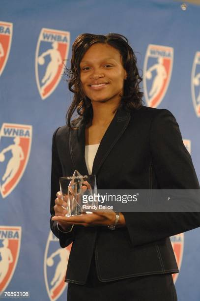 Armintie Price of the Chicago Sky poses with the trophy after a press conference naming her the 2007 WNBA Rookie of the Year at The Palace of Auburn...